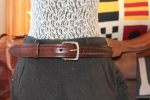 Brown leather belt with braiding and tooling